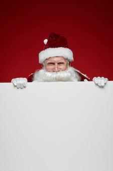 Kerstman met witte billboard