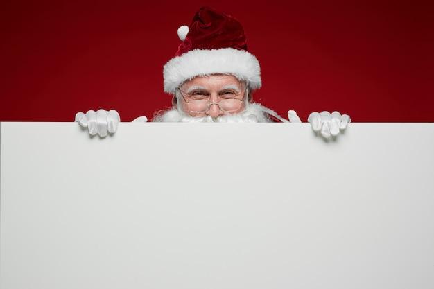 Kerstman met witte poster