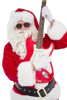 Kerstman met zonnebril die elektrische gitaar speelt
