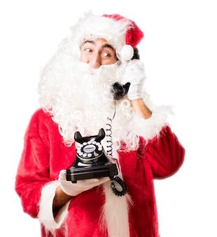 Kerstman praten over een oude telefoon