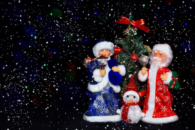 Kerstman sneeuwmeisje en sneeuwpop