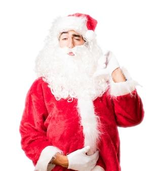 Kerstman wijst naar zichzelf