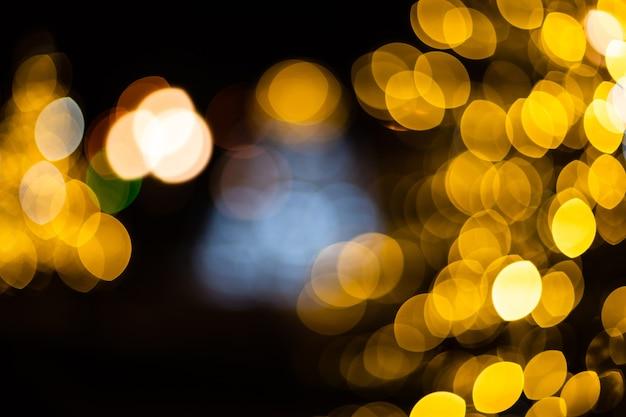 Kerstmis achtergrond. gouden vakantie abstracte glitter intreepupil achtergrond. wazig bokeh