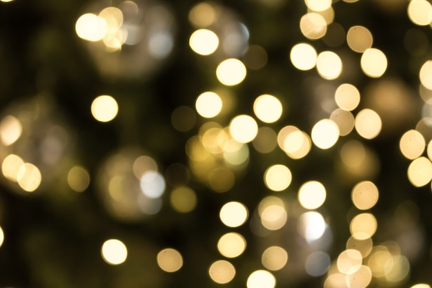 Kerstmis met gouden bokeh lichte achtergrond.