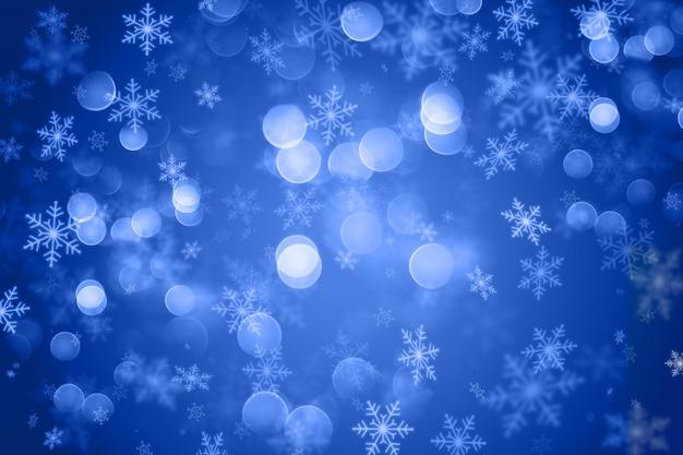 Kerstmis met sneeuwvlokontwerp en bokeh lichten