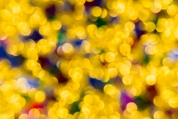 Kerstmis van abstracte gouden kleurenlichten
