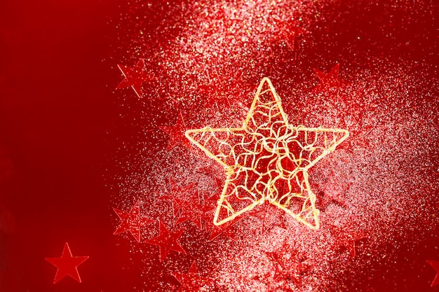 Kerstmisachtergrond met rode kleine sterren