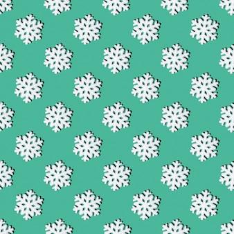 Kerstmisachtergrond met sneeuwvlokken. feestelijk naadloos patroon van witte sneeuwvlokken op een lichtgroene achtergrond, vierkante lay-out, bovenaanzicht