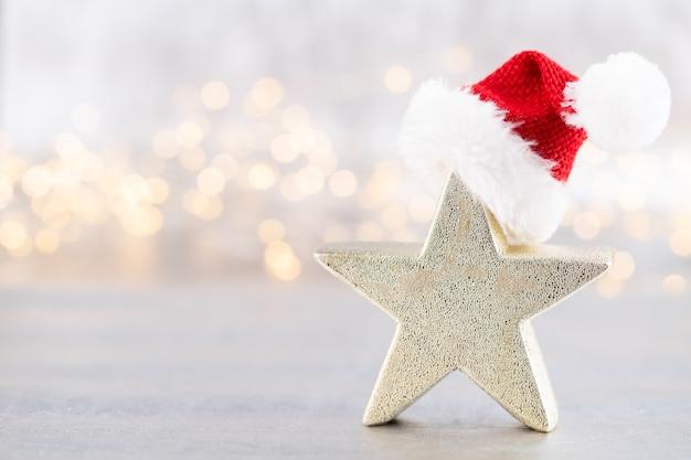 Kerstster, decor op bokeh zilveren achtergrond