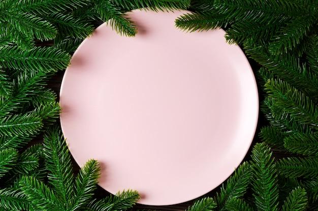 Kerststuk met roze plaat