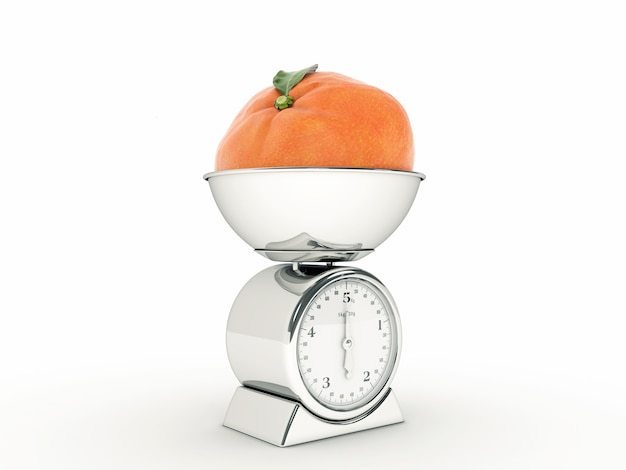Keukenweegschaal met gigantische mandarijn