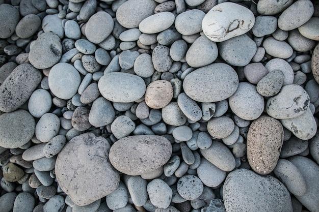 Kiezelsteen op de achtergrond van de strandtextuur