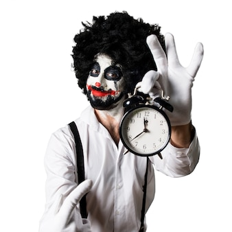 Killer clown holding vintage clock