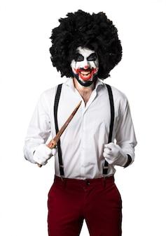 Killer clown met mes