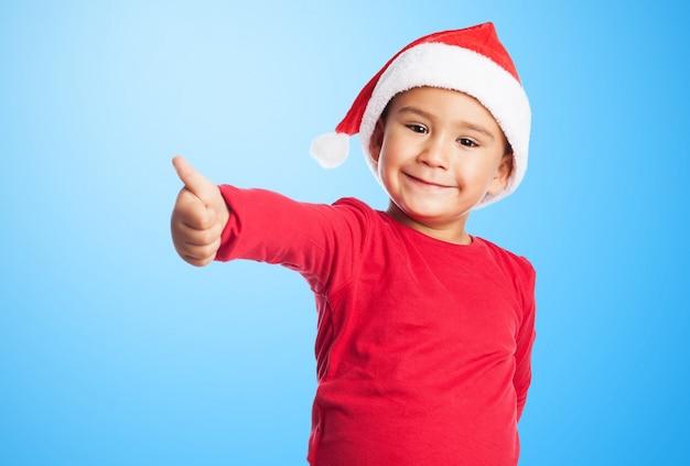 Kind met duim omhoog