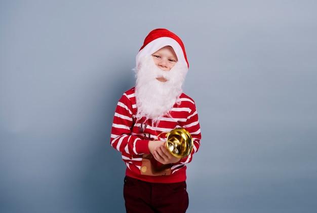 Kind met kerstmuts en baard