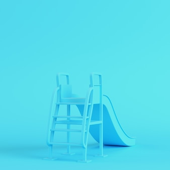 Kinderen glijden op een felblauwe achtergrond in pastelkleuren. minimalisme concept. 3d render