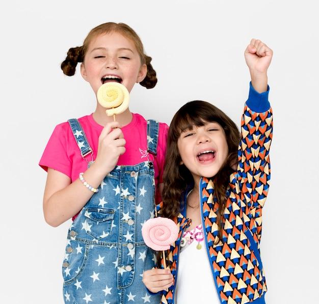 Kinderen glimlachend geluk studio portret sweet lollipop
