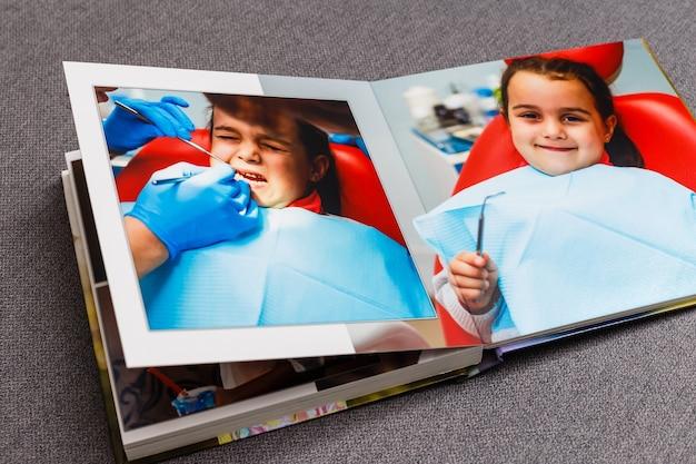 Kinderfotoboek, een klein meisje bij de tandarts