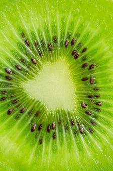 Kiwi macrotextuurplakje kiwifruit op een volledig frame horizontaal formaat