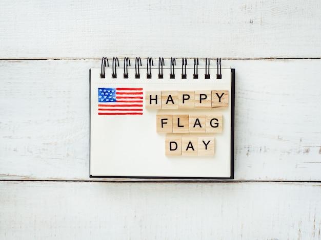 Kladblok met felicitaties op flag day