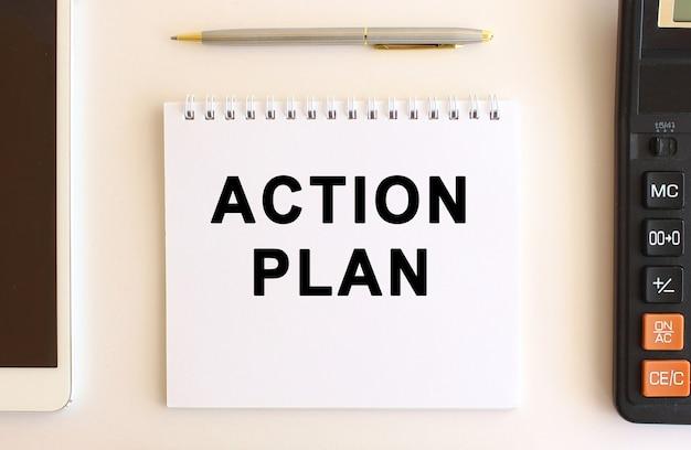 Kladblok met tekst actieplan