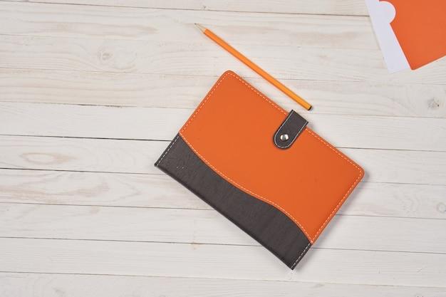 Kladblok pen schrijftafel briefpapier accessoires.
