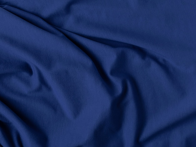 Klassieke blauwe kleur. geplooide stof textuur. concept voor huisontwerp, interieur