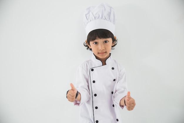 Klein kind beroep uniform doen alsof ze een chef-kok zijn