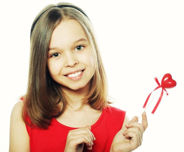 Klein meisje in een rode jurk