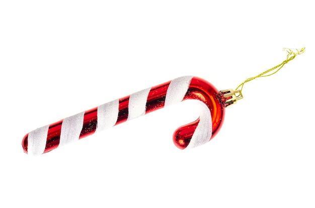 Klein plastic kerstmisspeelgoed dat op witte lijst wordt geïsoleerd.