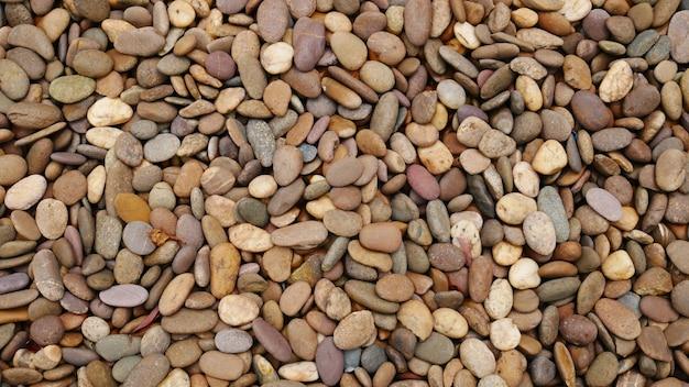 Kleine kiezelstrand stenen achtergrond