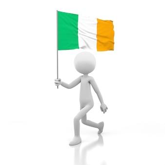 Kleine persoon die met de vlag van ierland in een hand loopt. 3d-rendering afbeelding