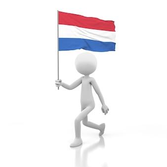 Kleine persoon lopen met nederlandse vlag in een hand. 3d-rendering afbeelding