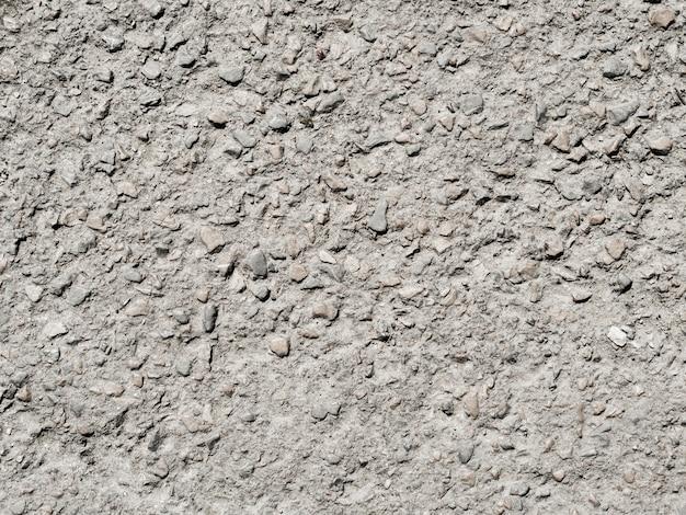 Kleine stenen getextureerde muur achtergrond