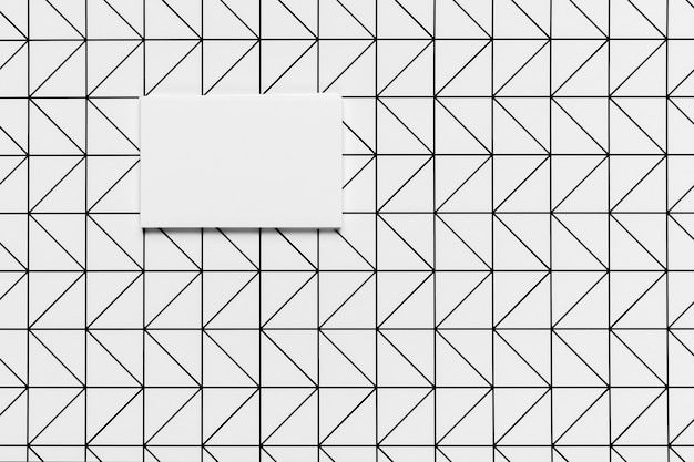 Kleine witte envelop met patroonachtergrond