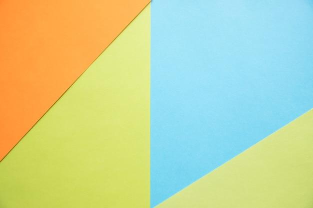 Kleur papieren geometrie platte samenstelling achtergrond met groen oranje en blauwe tonen nieuw minimaal plat ontwerp kleurrijk nieuw papier