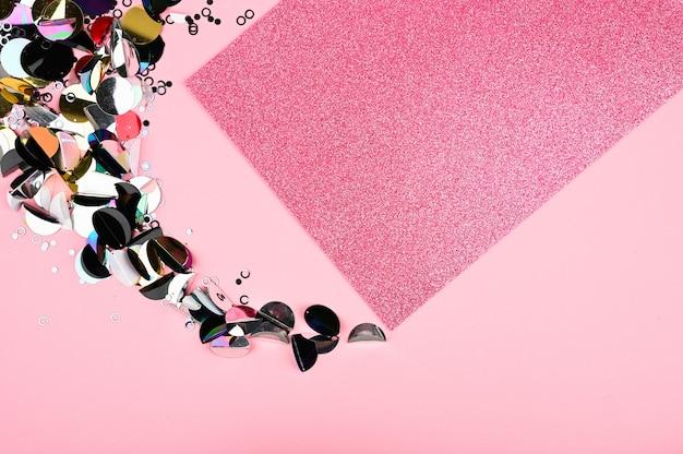 Kleur schittert en glitter op roze achtergrond