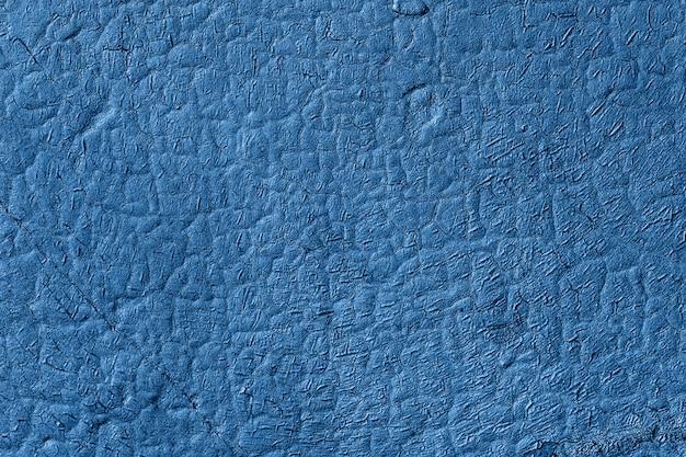 Kleur van het jaar 2020 klassiek blauw. achtergrond met abstracte textuur