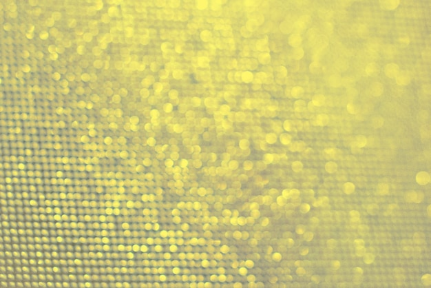 Kleuren van het jaar 2021 ultieme grijze en verlichte achtergrond. lichtbeige, gele wazige lichten. bokeh. textuur.