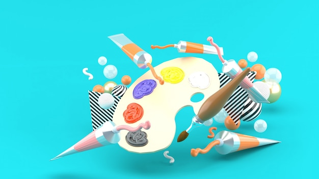 Kleurenpaletten en gekleurde buizen tussen kleurrijke ballen op een blauwe ruimte