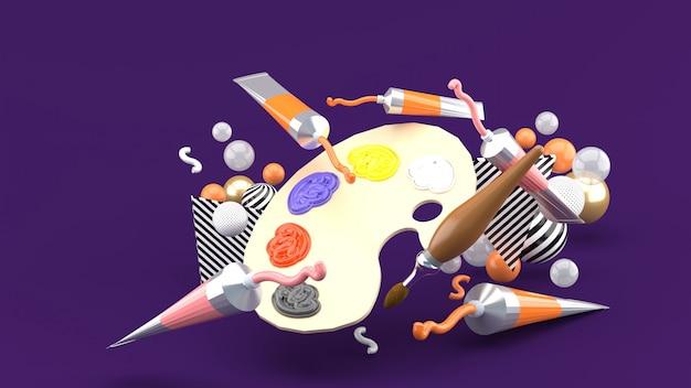 Kleurenpaletten en gekleurde buizen tussen kleurrijke ballen op een paarse ruimte