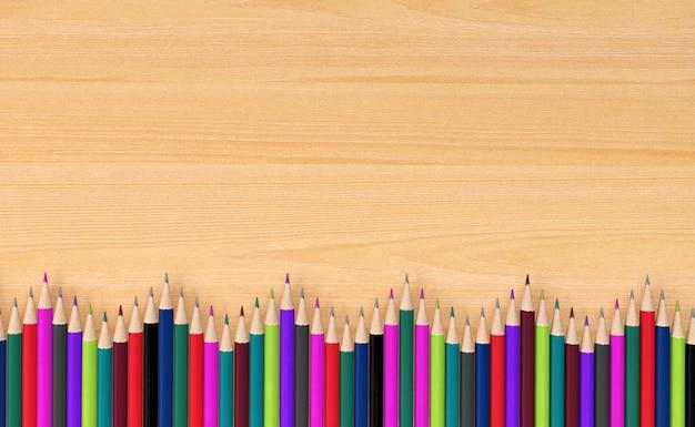 Kleurpotloden op houten raad voor achtergrond, het 3d teruggeven