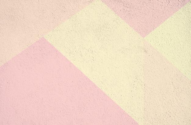Kleurrijk beton geschilderde textuur als achtergrond. roze geel