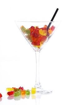 Kleurrijk kleverig draag suikergoed in het glas