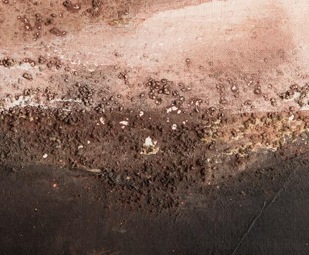Kleurrijke achtergrond samengesteld uit zandtextuur op canvas die een abstract landschap simuleert
