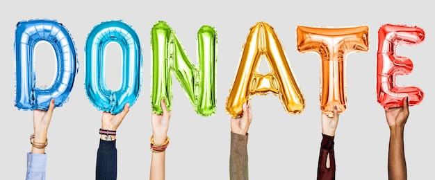 Kleurrijke alfabetballonnen die het woord doneren vormen