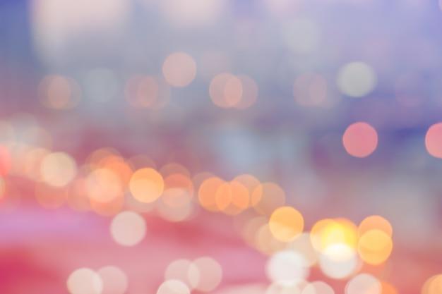 Kleurrijke bokehachtergrond de abstracte lichten defocused behang