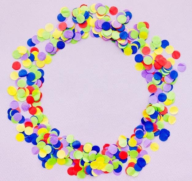 Kleurrijke confetti ronde frame