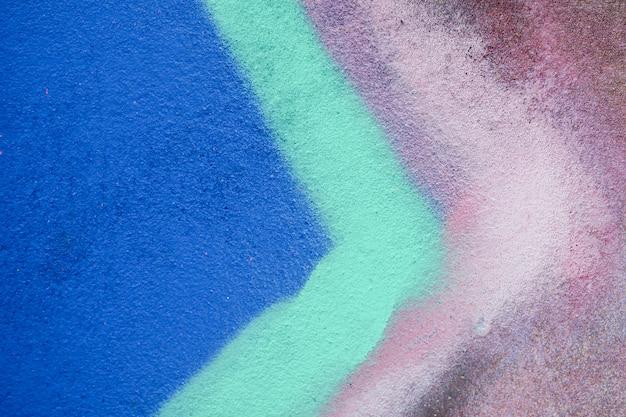 Kleurrijke graffititextuur op muur als achtergrond